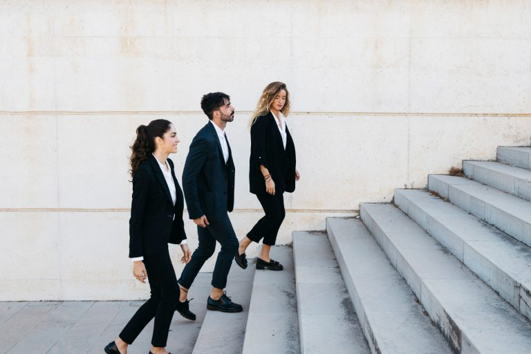 3 people in suits walking up steps hoping to boost their skill set